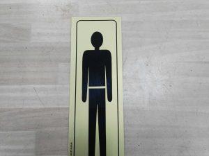 cartel hombre adhesivo 16.5x4.5cm
